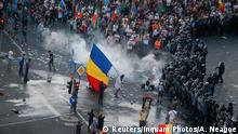 Protesters stand in front of police during a demonstration in Bucharest, Romania,