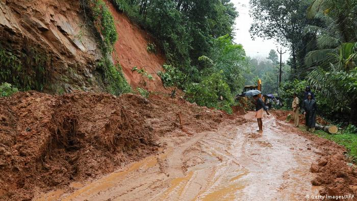 Indian rescuers conduct rescue operations after a landslide at Kuttampuzha village in Ernakulam district of Kerala.