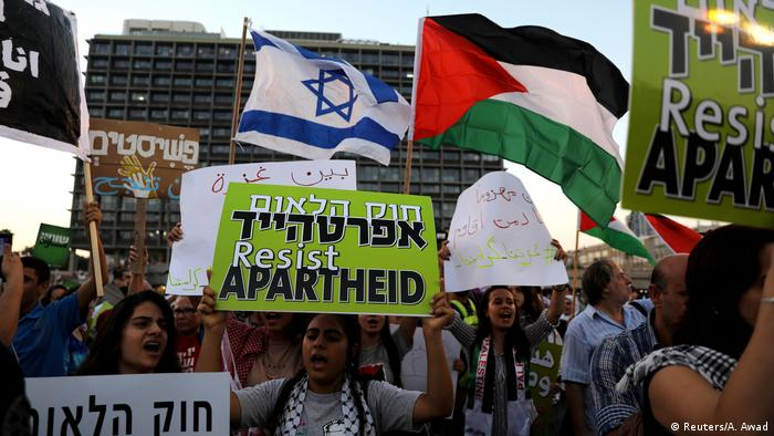Israeli Arabs and their supporters take part in a rally to protest against Jewish nation-state law in Rabin square in Tel Aviv, Israel