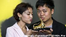 Filmmaker Yeo Siew Hua and actress Luna Kwok with the Golden Leopard for best film