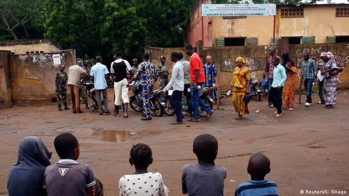 People wait outside Mali polling station (Reuters/L. Gnago)