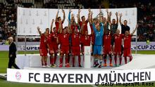 FRANKFURT AM MAIN, GERMANY - AUGUST 12: The team of Muenchen celebrate winning the Supercup 2018 after the DFL Supercup 2018 between Eintracht Frankfurt and Bayern Muenchen at Commerzbank-Arena on August 12, 2018 in Frankfurt am Main, Germany. (Photo by Martin Rose/Bongarts/Getty Images)
