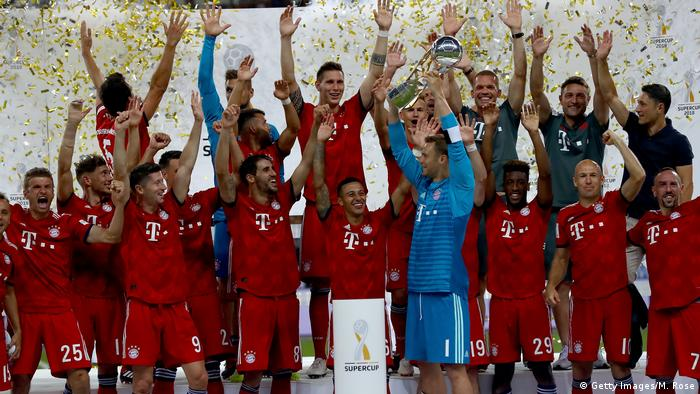 Bayern's players lift the Super Cup