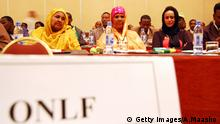 Female members of the ONLF attend the ceremony where their group signed a peace deal with the Ethiopian authorities in Addis Ababa on October 12, 2010. Ethiopia signed a peace deal today with a breakaway faction of the Ogaden National Liberation Front rebels who have waged a 25-year insurgency to gain autonomy of their oil-rich region. The deal was dismissed by the group's main body which has vowed to continue fighting. AFP PHOTO/Aaron Maasho (Photo credit should read AARON MAASHO/AFP/Getty Images)