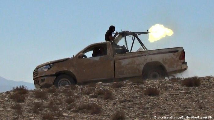 Still image taken from an ISIS propaganda video released October 10, 2017 showing the Islamic State militants firing a heavy machine gun from the back of a pickup truck during battles in Qaryatain, Syria