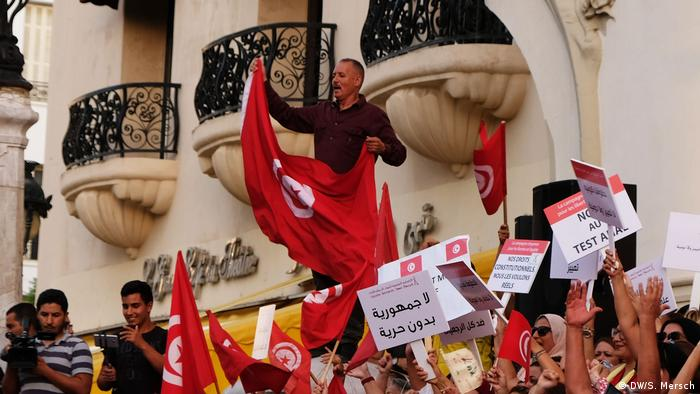 Protesters waving flags in Tunisia