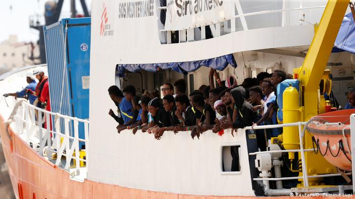 Migrants are seen onboard the humanitarian ship Aquarius