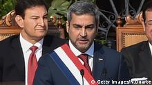 Paraguay's new President Mario Abdo Benitez (C) delivers a speech after being sworn-in, in Asuncion, on August 15, 2018. - Mario Abdo Benitez, of the right-wing Colorado party, was sworn-in Wednesday as President of Paraguay, with the challege of getting to agreements with the opposition. (Photo by NORBERTO DUARTE / AFP) (Photo credit should read NORBERTO DUARTE/AFP/Getty Images)