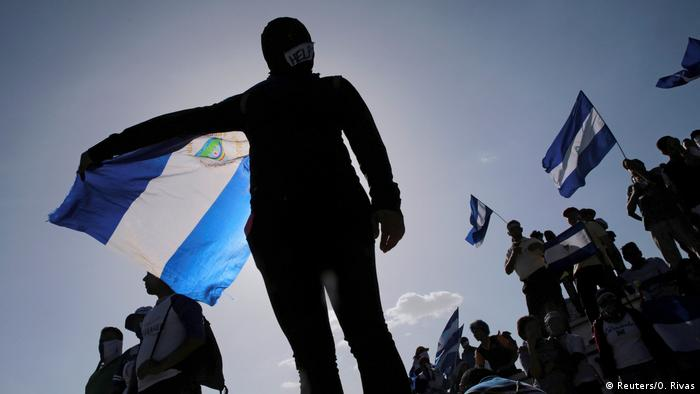 A protester holds a Nicaraguan flag