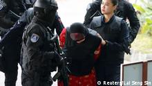 Siti Aisay is escorted to Malaysian court (Reuters/Lai Seng Sin)