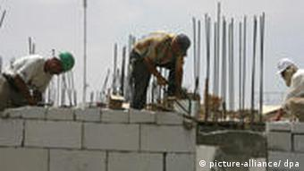 Construction workers building a settlement in Palestinian territory