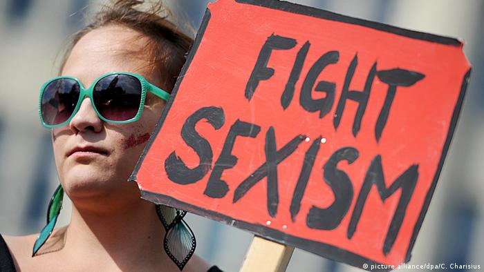 A German demonstrator holds a placard reading FIGHT SEXISM. Archive photo from 2011, Hamburg demonstration.