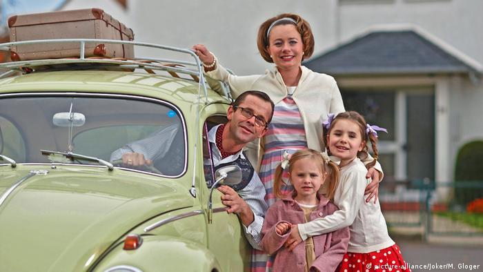 1950s German family in their Volkswagen
