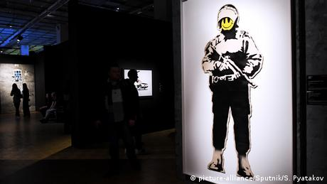 An early show of the exhibition of English street artist Banksy at a Moscow gallery.