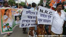 30.07.2018 *** Indian children along with Trinamool Congress party supporters hold placards reading NRC- New Terroism act in India during a protest following the publication of a draft of the National Register of Citizens (NRC) in Siliguri on August 4, 2018. - India on July 30 stripped four million people of citizenship in the northeastern state of Assam, under a draft list that has sparked fears of deportation of largely Bengali-speaking Muslims. (Photo by DIPTENDU DUTTA / AFP) (Photo credit should read DIPTENDU DUTTA/AFP/Getty Images)