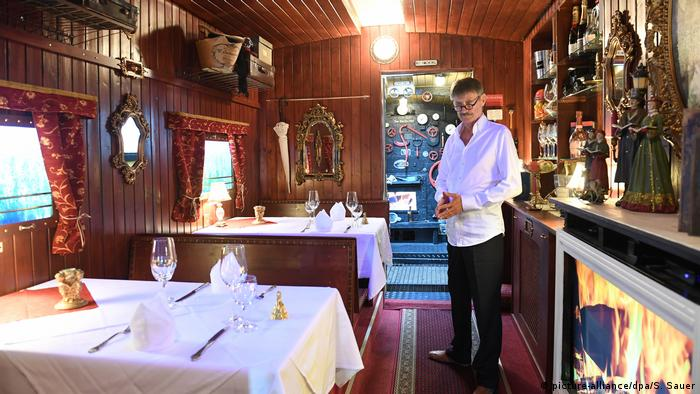 Rudolf Markl standing in his 'Adult's only' restaurant