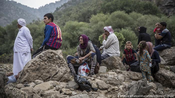 Yazidi refugees flee the Islamic State militant group