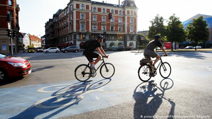Two cyclists at a cross-roads in Copenhagen
