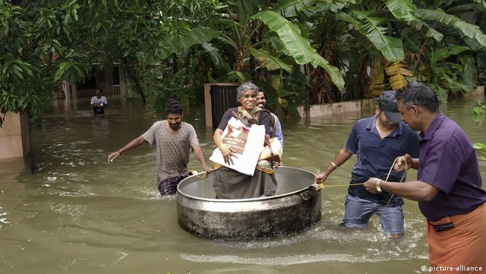 An elderly woman being rescued in Kerala.