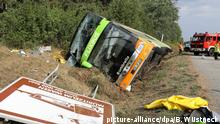 Long distance Flixbus lies in a ditch next to the A19