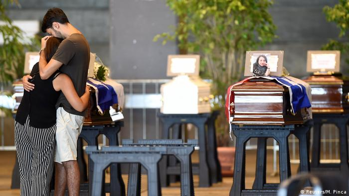 Coffins containing bodies of victims of the Genoa bridge collapse are seen at the Genoa Trade Fair and Exhibition Centre in Genoa.