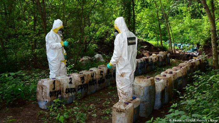 Mexican Navy forensic scientists at the site of the meth haul