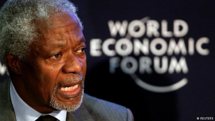 Annan speaks against the backdrop the WEF logo (REUTERS)