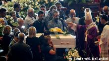 18.08.2018*** Archbishop of Genoa, Cardinal Angelo Bagnasco, blesses the coffin during the state funeral of the victims of the Morandi Bridge collapse, at the Genoa Trade Fair and Exhibition Centre in Genoa, Italy August 18, 2018. REUTERS/Stefano Rellandini