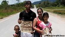 A family from Venezuela trying to make their way to Boa Vista (photo: Reuters/N.Doce)