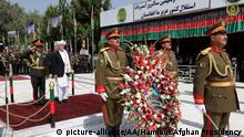 Afghan President Ashraf Ghani lays a wreath at the Independence Monument in the Ministry of Defense compound on Independence Day.