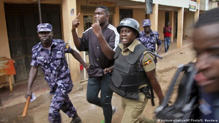 Police detaining an opposition supporter