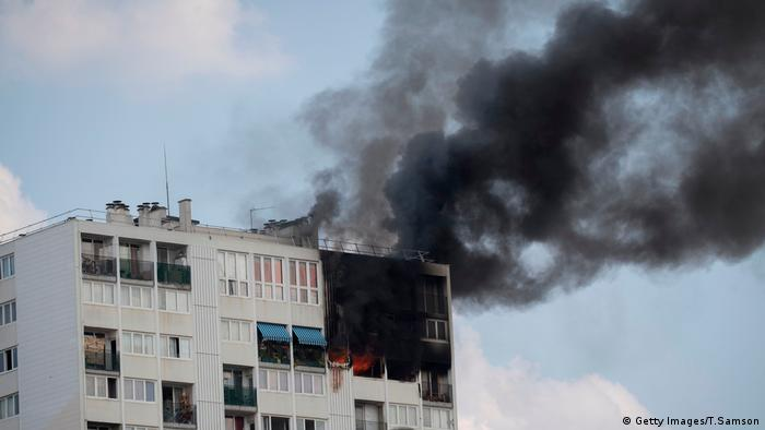 Black smoke rises from a burning apartment, in Aubervilliers, north-eastern suburbs of Paris, on July 26, 2018