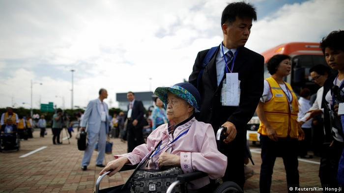 Woman sitting in wheelchairs (Reuters/Kim Hong-Ji)