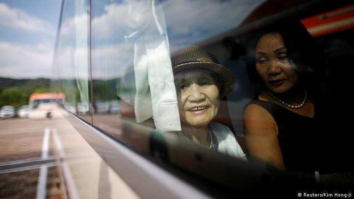 Woman sitting in bus on way to reunion (Reuters/Kim Hong-Ji)