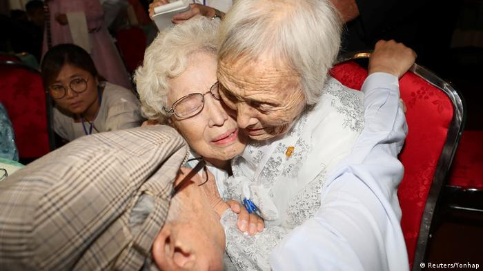 Three elderly people hugging (Reuters/Yonhap)