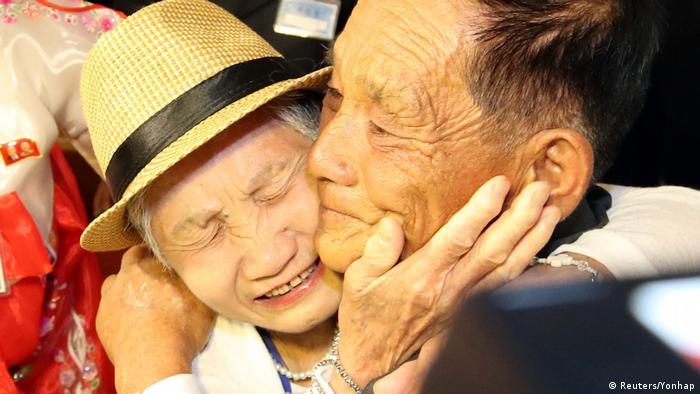 Womand and man hugging (Reuters/Yonhap)