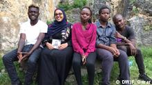 From left Kelvin OmondI a.k.a Ohms Law Montana, Fathiya Omar, DW Correspondent in Mombasa, Krispee, John Tsuma Mumba and Ali Rashid.