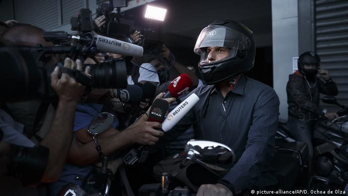 Former Finance Minister Yanis Varoufakis talks to reporters