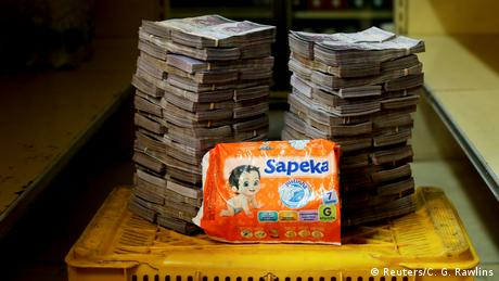 A package of diapers is pictured next to 8,000,000 bolivars