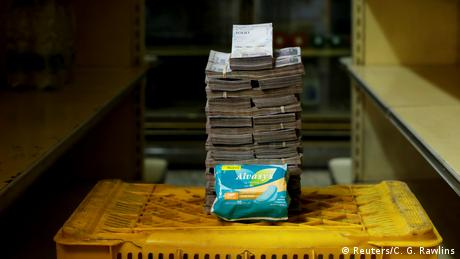 A package of pads is pictured next to 3,500,000 bolivars