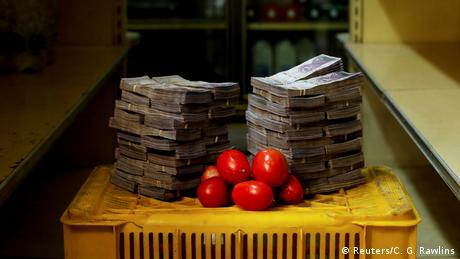 A kilogram of tomatoes is pictured next to 5,000,000 bolivars