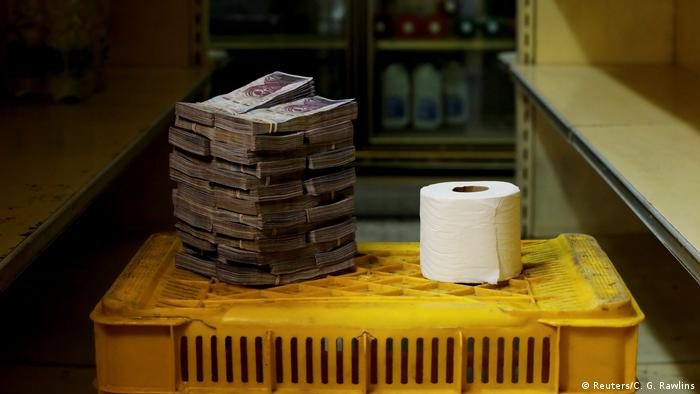 A toilet paper roll is pictured next to 2,600,000 bolivars