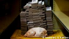 A 2.4 kg chicken is pictured next to 14,600,000 bolivars