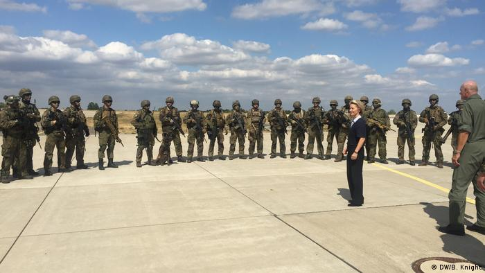 Von der Leyen stands in    front of troops (DW/B. Knight)