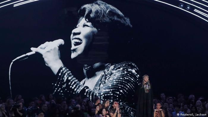 Aretha Franklin in a large black and white projection, Madonna and others at front (Reuters/L. Jackson)