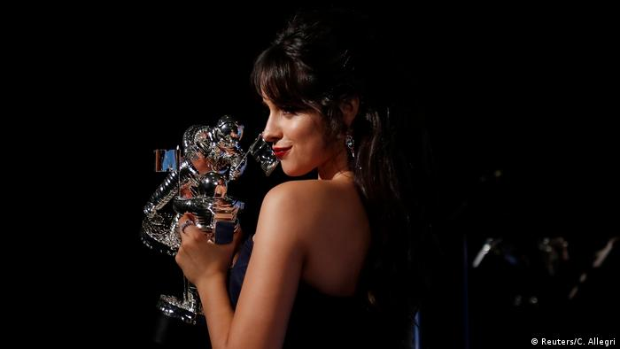 Camila Cabello holding her trophy (Reuters/C. Allegri)