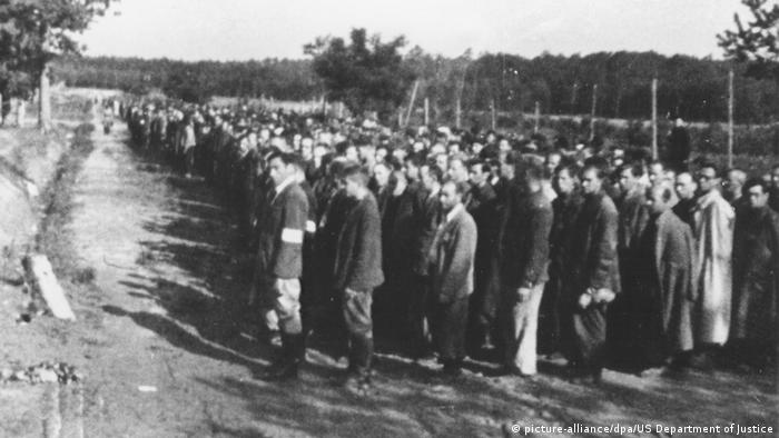Men stand in lines in the Trawniki concentration camp