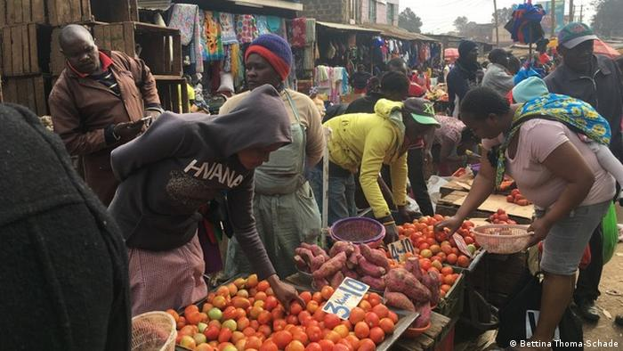 Market traders and shoppers