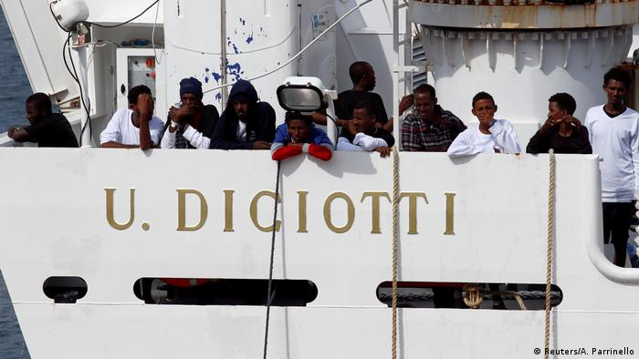 Migrants on board the Diciotti rescue ship in the port of Catania