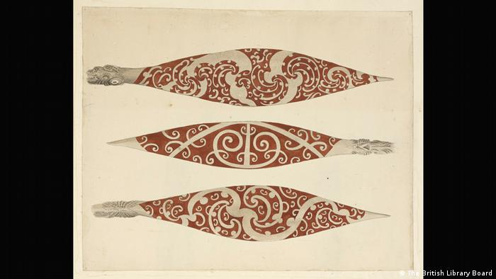 Three paddles decorated with a red Maori design. (The British Library Board)